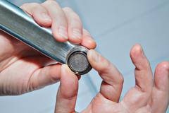 Install tap aerator, tighten the nut, close up. Stock Photos