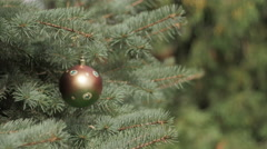 Decorated Christmas tree on blurred, black background Stock Footage