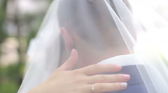 Bride lays down his hand on the shoulder of the groom. Stock Footage
