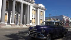 A large stately building stands in the central square of Cienfuegos, Cuba with Stock Footage