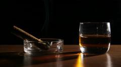 Whiskey drinks with smoking cigars Stock Footage
