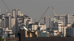 Timelapse of building cranes working in Seoul, South Korea Stock Footage