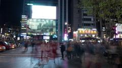 Timelapse of pedestrians on zebra crossing in night Seoul, South Korea Stock Footage