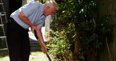 4k, Mature man has a painful backache while gardening. Stock Footage