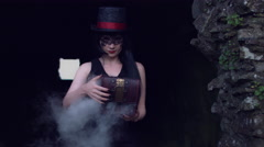 4k Halloween Shot of a Witch Opening a Box with Smoke Stock Footage