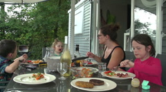 Family With Young Children Having An Outdoors Meal With Holiday Chalet In Stock Footage
