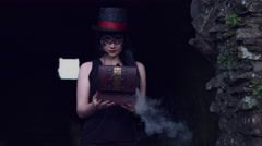 4k Halloween Shot of a Witch Closing a box with Smoke Stock Footage