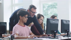 Teacher Talking with Students and Helping them in Computer Class. Stock Footage