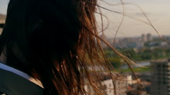Back view. close-up Wind blows long dark hair beautiful young women. girl Stock Footage