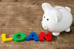 Piggy bank with a word LOAN Stock Photos