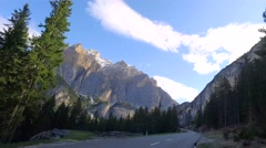 Sunrise from mountains road in Passo Falzarego, Dolomites, Italy Stock Footage