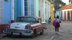 A beautiful shot of the buildings and cobblestone streets of Trinidad, Cuba with Stock Footage