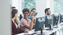 Smiling and Laughing Students in Computer Class before Lecture. Stock Footage
