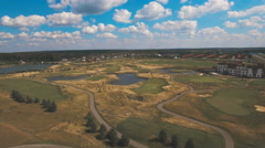 Aerial view of golf course and water Stock Footage