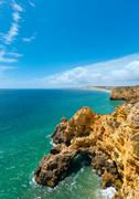 Atlantic rocky coastline (Algarve, Portugal). Stock Photos