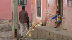 People sit on the street and watch the world go by, Trinidad, Cuba. Stock Footage