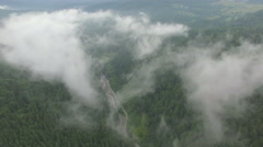 Drone flying in the clouds above the mountains Stock Footage