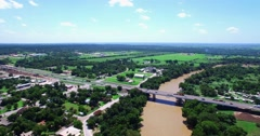 Aerial Footage - Flying down the Colorado toward Highway 71 in Bastrop, TX Stock Footage