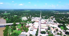 Aerial Footage - Flying down Main St in Old Town Bastrop, TX Stock Footage