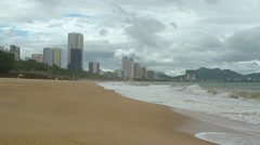 Waves on a Beach under Highrise Buildings of Nha Trang, Vietnam Stock Footage