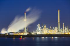 View over the Scheldt river in Antwerp, Belgium to a large oil refinery with  Stock Photos