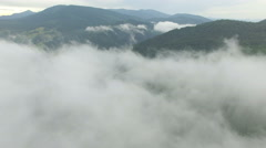Beautiful clouds in the mountains. drone flight Stock Footage