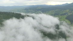 Aerial view above the clouds in the mountains Stock Footage