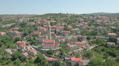 Aerial view of a cozy mediterranean village between the mountains - Lozisca, Cro Stock Footage