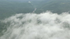 Aerial view high above the clouds in the mountains Stock Footage
