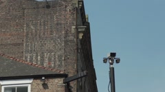 Cctv security camera against old building in city Stock Footage