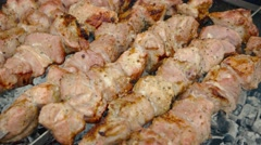 Pork Kebabs Barbecuing over Coals. 4k UltraHD video Stock Footage