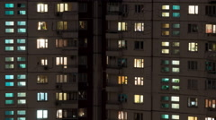 Time lapse shot of buildings and lighted windows at night Stock Footage