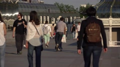 Ordinary Russian People walk along pedestrian promenade, telephoto view Stock Footage