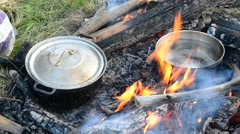 Cooking on open fire with wooden logs Stock Footage