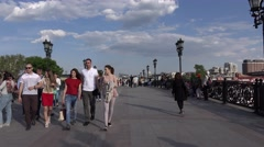 POV walk along Patriarshy Bridge, group of asian tourists, ordinary citizens Stock Footage