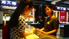Chinese women in the jewelry shop to buy gold rings Stock Footage