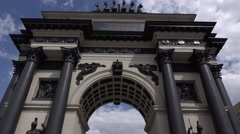 Dolly camera move away from Moscow Triumphal Arch, low angle shot Stock Footage