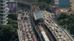 Time lapse shot of multi-level traffic road, railway and train station. Bangkok Stock Footage