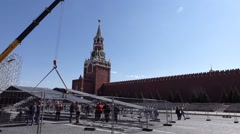 Mobile crane lift part of detachable construction after event on Red Square Stock Footage