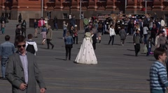 Ordinary busy people quickly go on Manezhnaya square, lively area Stock Footage
