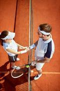 Tennis teacher congratulate to sportswoman Stock Photos