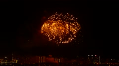 Commemorative fireworks over dormitory area, large explosions in black sky Stock Footage