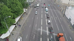 Aerial view of city motorway with public transport stop Stock Footage
