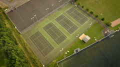 Tennis courts pan around aerial view Stock Footage
