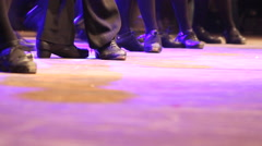 Two rows of people doing Irish dance with traditional step shoes Stock Footage