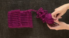 Clewing the purple yarn up Stock Footage