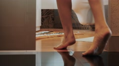 Girl walk to bathroom, open door and come to sink. Little carpets. Apartment Stock Footage