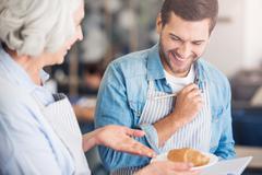 Positive baker sharing receipts Stock Photos