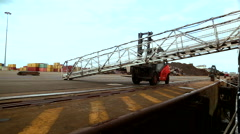 Fork lift shifting ship's gangway port Montori France April 2016 Stock Footage