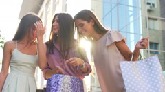 Portrait of three beauty, that shows their purchases to each other. They delight Stock Footage